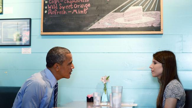 US President Barack Obama meets with Kinsey Button, a student at the University of Texas. AFP/Jewel Samad