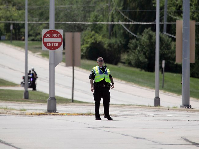 Police block an intersection near the Sikh Temple in Oak Creek, where a shooting occurred on Sunday, Aug. 5, 2012. AP Photo/Milwaukee Journal-Sentinel, Mike De Sisti