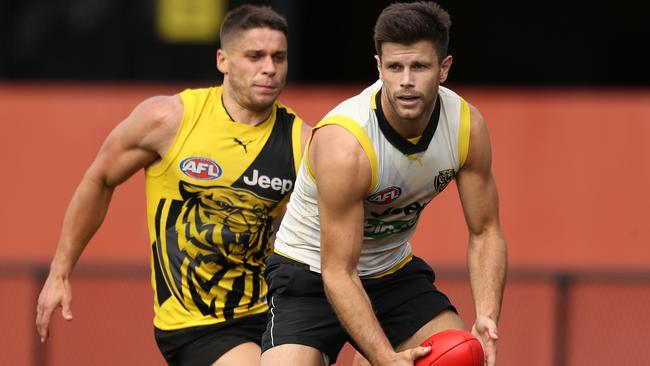 Trent Cotchin is tracked by Dion Prestia.