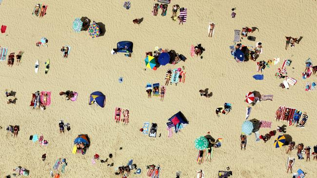 An aerial of the a crowd at Burleigh Heads. Pic by Luke Marsden