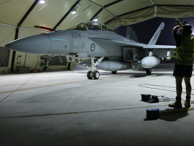 Mission complete ... A RAAF Super Hornet in its hangar after completing the first combat mission.