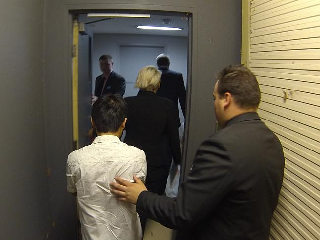 Detectives escort Changjie Wang, 23, following his extradition from Western Australia. Picture: Police Media