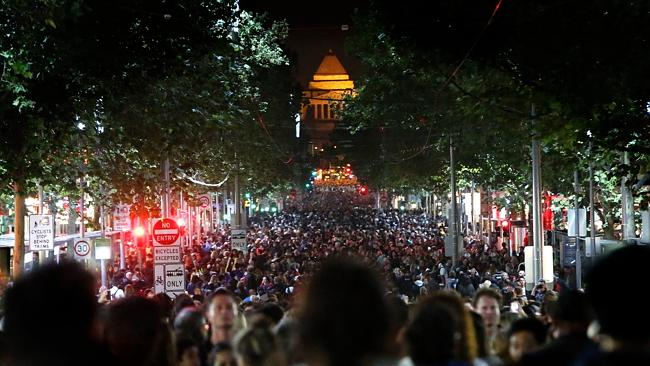 Crowds on Swanston Street. Picture: Hamish Blair