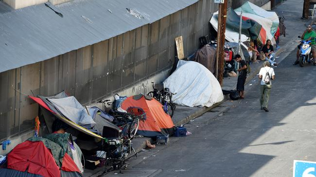 Tents form makeshift footpath camps which stretch for blocks in Skid Row. Picture: Robyn Beck//AFP
