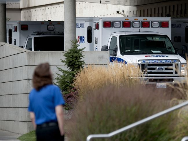Ambulances line up in the emergency area of Sacred Heart Hospital following reports of a shooting at Freeman High School. Picture: Kathy Plonka/The Spokesman-Review via AP