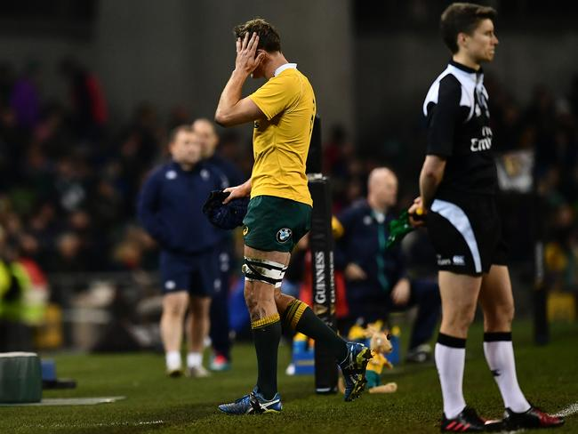 Dean Mumm leaves the field after being shown a yellow card by referee Jerome Garces during the international match between Ireland and Australia at the Aviva Stadium.