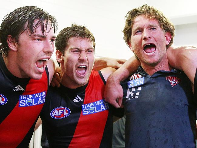 Bombers coach James Hird celebrates the win with Michael Hibberd and Ben Howlett in Round 3, 2013. Photo by Michael Dodge