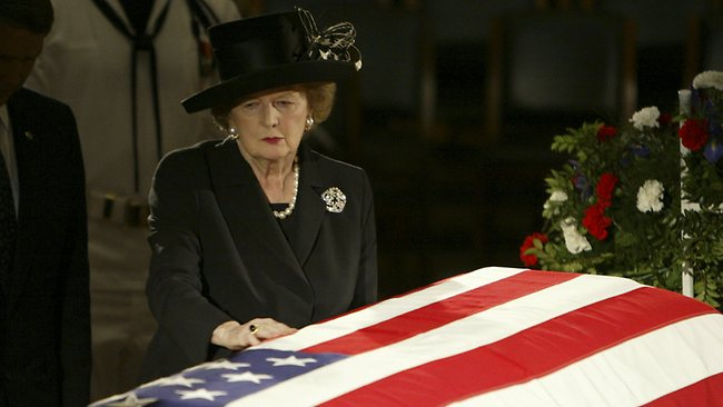 Thatcher pauses at the casket of former US President Ronald Reagan as he was laying in state in the Capitol Rotunda on Capitol Hill in Washington on June 9, 2004. Picture: AP