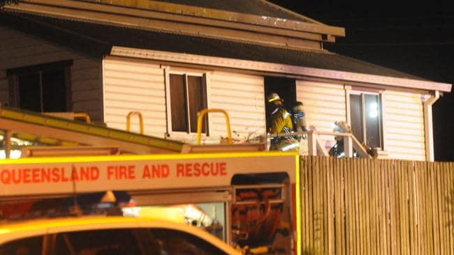 Firefighters at the Kenilworth St addresss where a child died in a house fire. Pic: David Martinelli