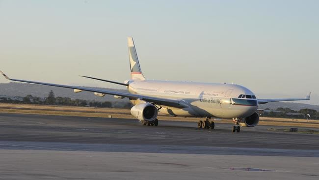 A Cathay Pacific flight arrives at Adelaide Airport.