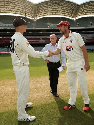 Peter Handscomb of the Bushrangers and acting Redbacks captain Tom Cooper at the start of play. Picture: AAP Image/James Elsby