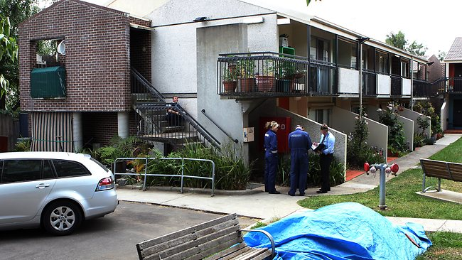 Police at an apartment block in Caroline St, Hawthorn after a man was arrested over the murder of Sarah Cafferkey. Picture: Ian Currie