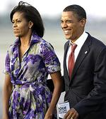 <p>Democratic presidential candidate Sen. Barack Obama, D-Ill., walks on the tarmac with his wife Michelle Obama after arriving in Chicago, Ill. Saturday, Aug. 23, 2008.</p>