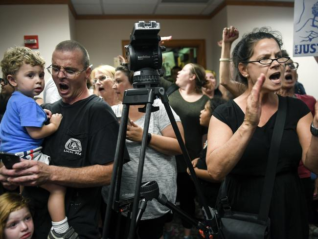 Angry protesters briefly took over the press conference. Picture: Aaron Lavinsky/Star Tribune via AP