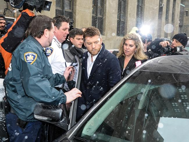 In trouble ... Sam Worthington leaves court after being arrested in New York City. Picture: Dave Kotinsky/Getty Images