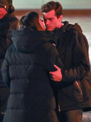 First kiss ... Dakota Johnson and Jamie Dornan on the 50 Shades of Grey set in Vancouver.