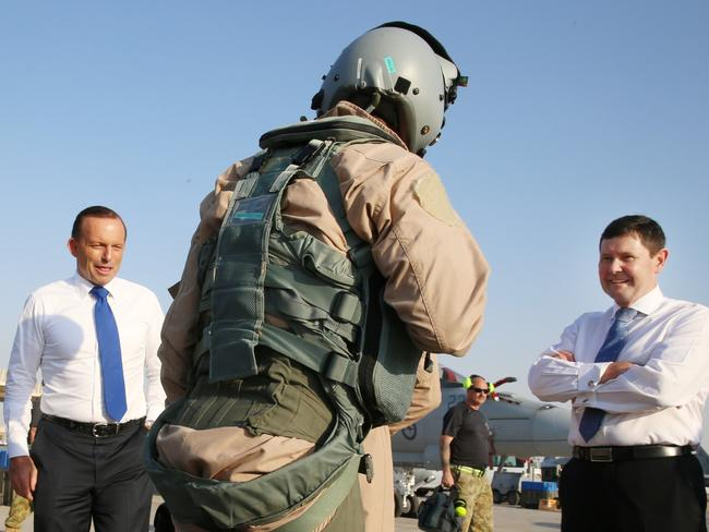Abbott and new Minister for Defence Kevin Andrews speak with an FA18 pilot. Picture: Gary Ramage