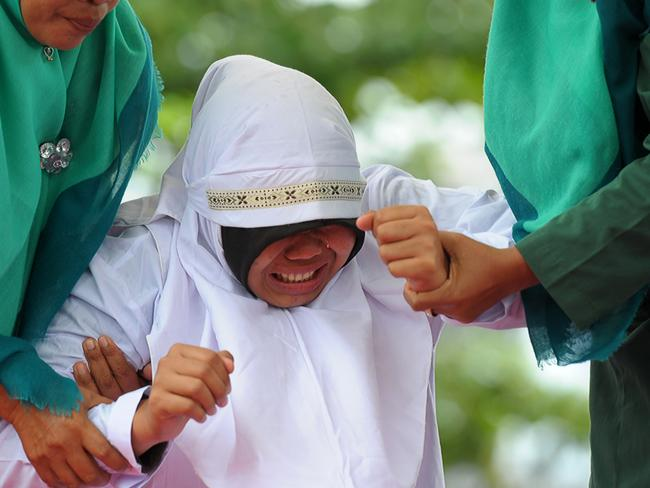 Out of seven couples caught spending time together outside marriage, 13 were caned while one girl was spared after it was discovered that she was pregnant. Picture: Chaider Mahyuddin