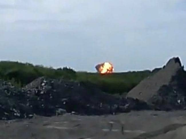 Moment of impact ... in this image taken from amateur video, a fireball is seen shortly after the plane was shot down.