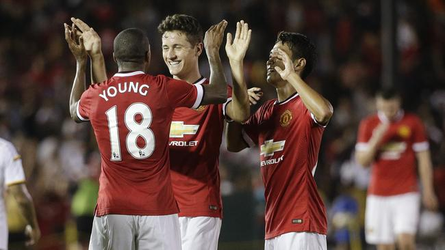 Manchester United's Ashley Young celebrates his goal with Ander Herrera and Shinji Kagawa.