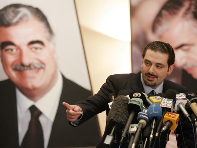 Saad Hariri speaks in front of pictures showing hsi father and former Prime Minister Rafik Hariri, who was killed by a car bomb. Picture: Supplied