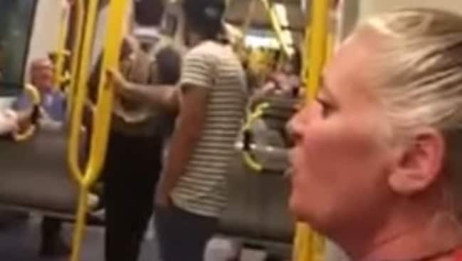 The woman was booed and shouted down by fellow tram passengers.