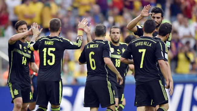 Spain bow out on a happy note.