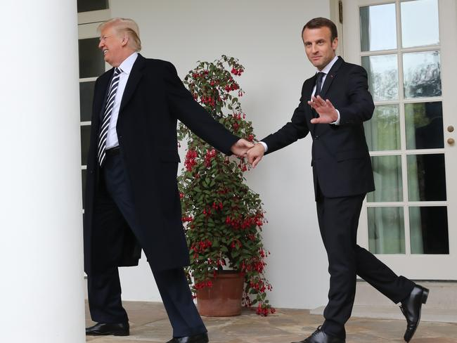 Donald Trump had more luck taking the hand of French President Emmanuel Macron at the White House. Picture: AP Photo/Pablo Martinez Monsivais
