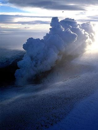 A plane flies over an ash cloud from a volcano eruption in the middle of Vatnajokull, the biggest glacier in Iceland.