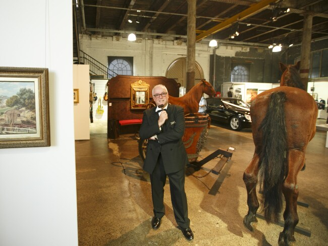 Auctioneer Martin Gallon among many of Russell Crowe's items. Photo: Tim Pascoe