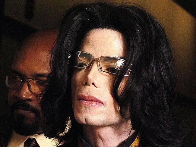 Michael Jackson leaves court during a break in testimony in his child molestation trial at the Santa Barbara County Courthouse in Santa Maria, California. Picture: Phil Klein