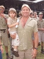 <p>Terri and Steve Irwin with Bindi and Zoo Director Wes Mannion in front of new building upon the expansion of Australia Zoo in 2002. Picture: Graeme Parkes</p>