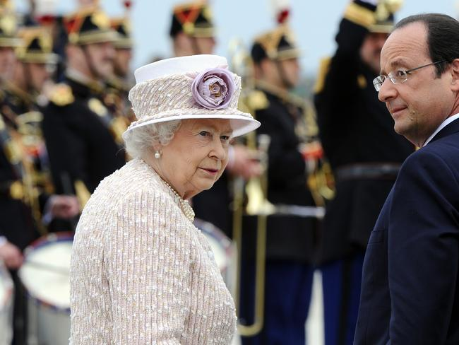 Fond farewell... The Queen and French President Francois Hollande inspect troops during a departure ceremony at the Villacoublay airport in Paris. Picture: Frederic T Stevens