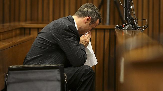 Sickening .. Oscar Pistorius blows his nose after reaching for a bucket and vomiting during cross-examination.