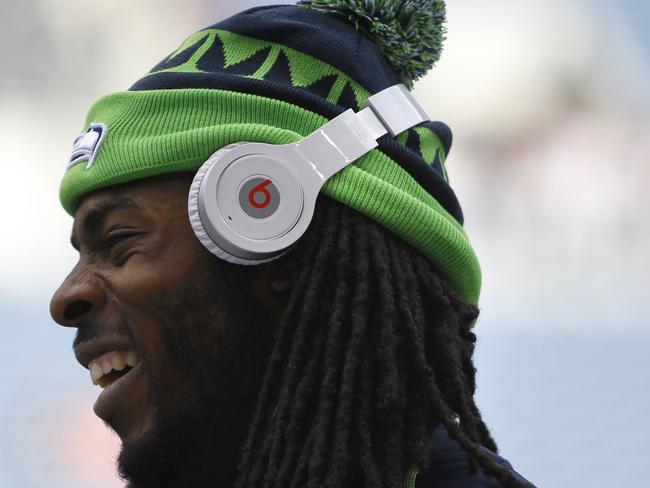 Seattle Seahawks' Richard Sherman wears Beats headphones. Beats was purchased by Apple earlier this year.