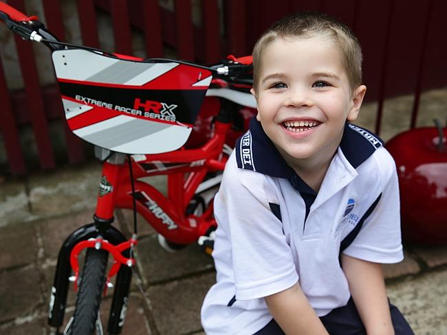 Doing his best ... five-year-old Joshua Whicker has problems walking and talking as a result of the Meningococcal B infection.