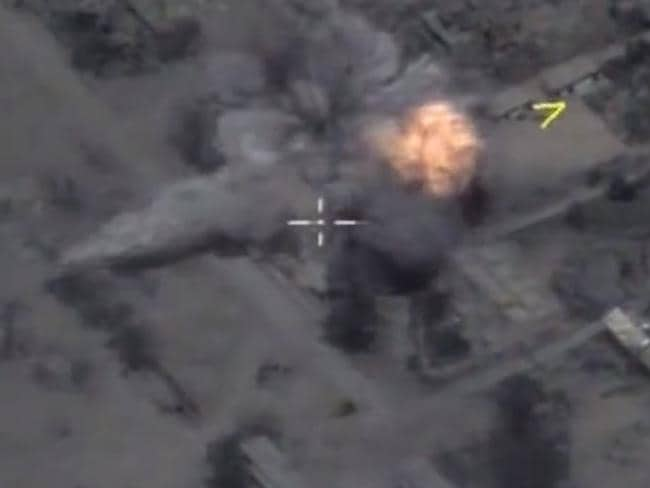 A screen capture of Russian Ministry of Defence footage purporting to show cruise missiles from the submarine Krasnodar striking targets near Palmyra, Syria, earlier this year.