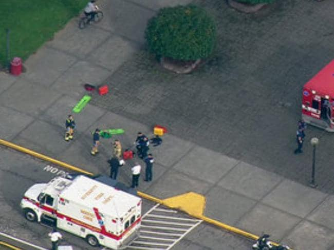 Lockdown ... emergency personnel responding after reports of a shooting at Marysville-Pilchuck High School. Picture: AP Photo/KOMONews.com