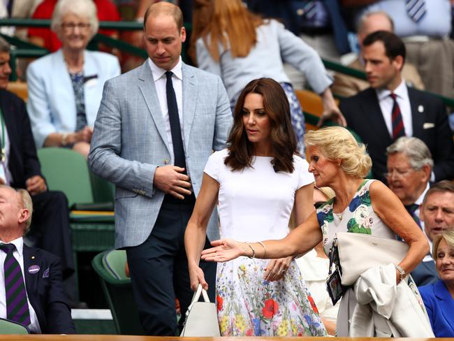 Prince William, Duke of Cambridge and Catherine, Duchess of Cambridge and welcomed by Gill Brook in the centre court royal box prior to the Men's Singles final between Roger Federer and Marin Cilic. Picture: Clive Brunskill/Getty Images