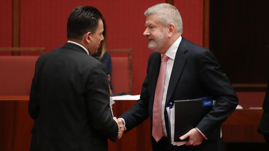Senator Nick Xenophon and Communications Minister Senator Mitch Fifeld after the vote yesterday. Picture: Gary Ramage