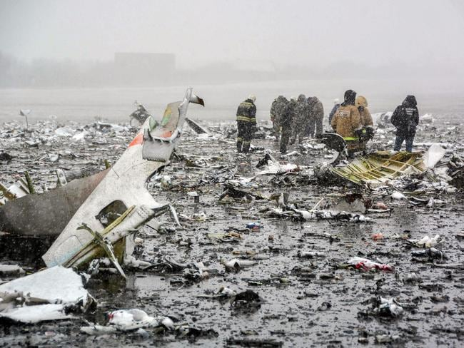 Russian rescuers examine the site of the FlyDubai crash in southern Russia in 2016. The Boeing 737 was attempting to land in bad weather when it crashed short of the runway. Picture: AFP/Russian Emergencies Ministry/STR