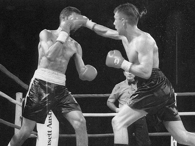 Kostya Tszyu delivers an overhand right that finds its target as he fights on the front foot.