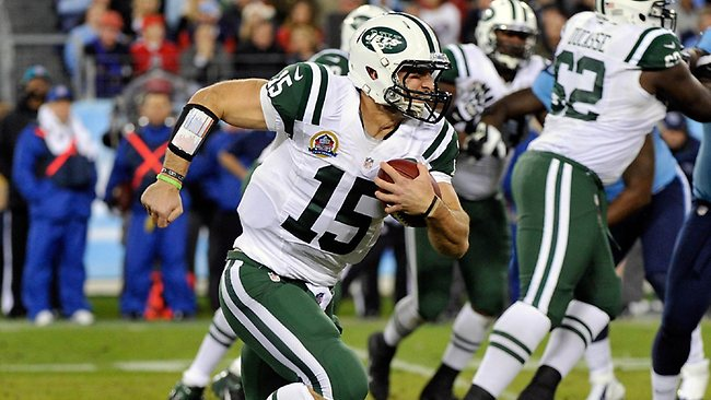 Tim Tebow runs the ball against the Tennessee Titans. Picture: Frederick Breedon