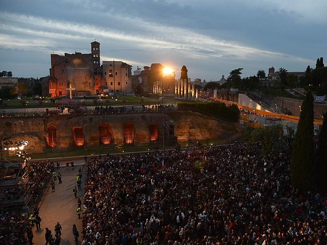Faithful gather ... the Celebration of the Way of the Cross on Good Friday took place near the Colosseum in Rome. Picture: Vincenzo Pinto