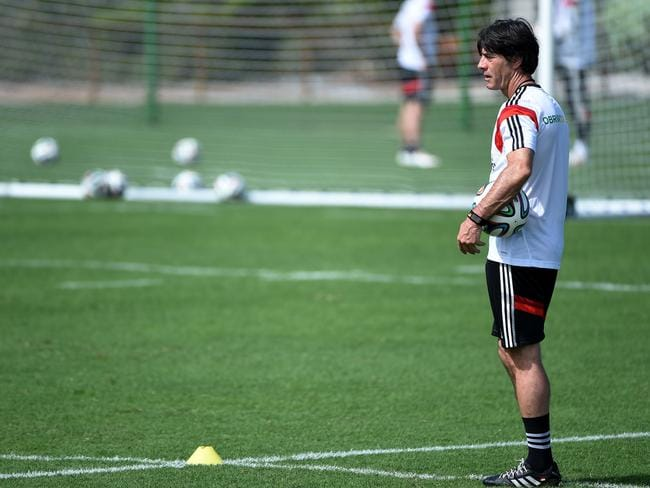 Germany's coach Joachim Loew overlooks his mannschaft. Sorry, but we just had to say that. AFP PHOTO / PATRIK STOLLARZ