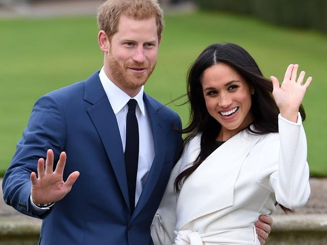 Prince Harry and Meghan Markle pose for the media after announcing their engagement. Picture: Eddie Mulholland/Pool via AP