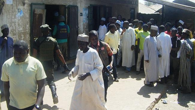 Mob 'justice' ... a crowd gathering outside the Unguwar Jaki Upper Sharia Court in the northern Nigerian city of Bauchi during the trial of seven suspected homosexuals.