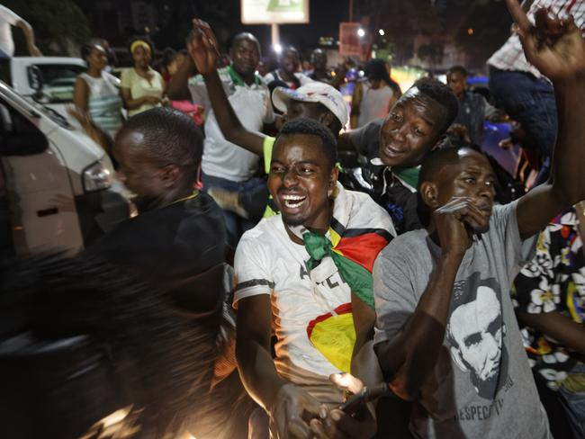 Zimbabweans drink, dance, and sing as they celebrate at an intersection in downtown Harare. Picture: AP