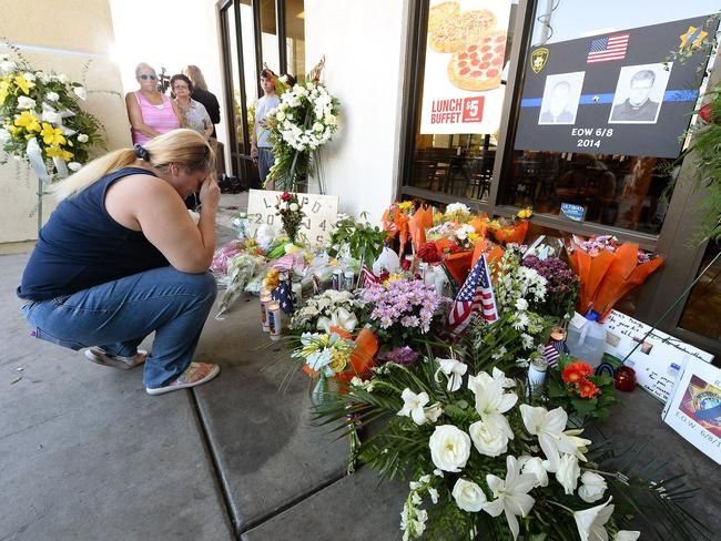 Shootout ... Brenda Williams of Nevada prays at a memorial during a vigil outside CiCi's Pizza in Las Vegas, Nevada. Picture: Getty/AFP