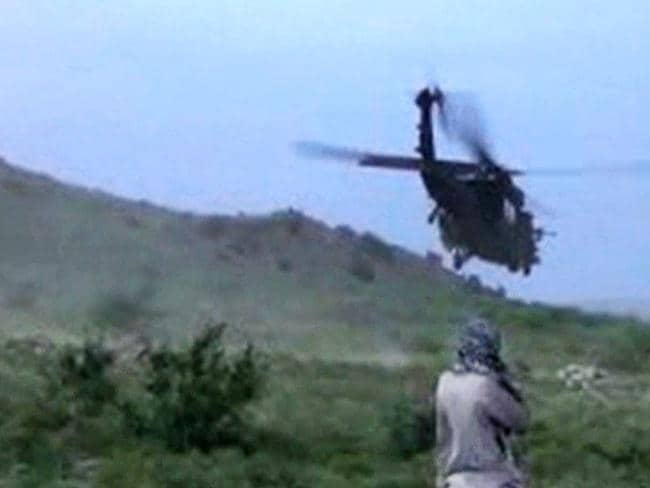 Moment of freedom ... a US helicopter carrying Bowe Bergdahl takes off after his handover.